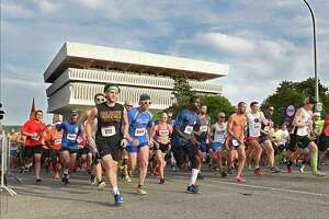 The front of the pack runs up Madison Ave. in the CDPHP Workforce Team Challenge 5K on Thursday, May 17, 2018 in Albany, N.Y. (Lori Van Buren/Times Union)