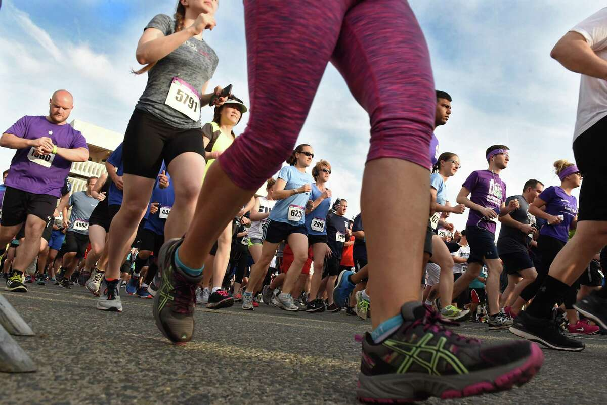 Runners make their way up Madison Ave. in the CDPHP Workforce Team Challenge 5K on Thursday, May 17, 2018 in Albany, N.Y. (Lori Van Buren/Times Union)