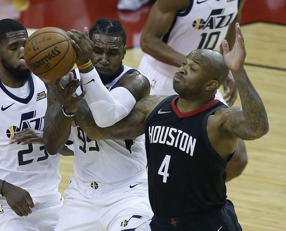 Houston Rockets forward PJ Tucker (4) battles with Utah Jazz forward Jae Crowder (99) for a loose ball during the second half in Game 5 of an NBA basketball second-round playoff series at Toyota Center, Tuesday, May 8, 2018, in Houston. ( Michael Ciaglo  / Houston Chronicle ) Photo: Michael Ciaglo, Staff / Houston Chronicle / © 2018 Houston Chronicle