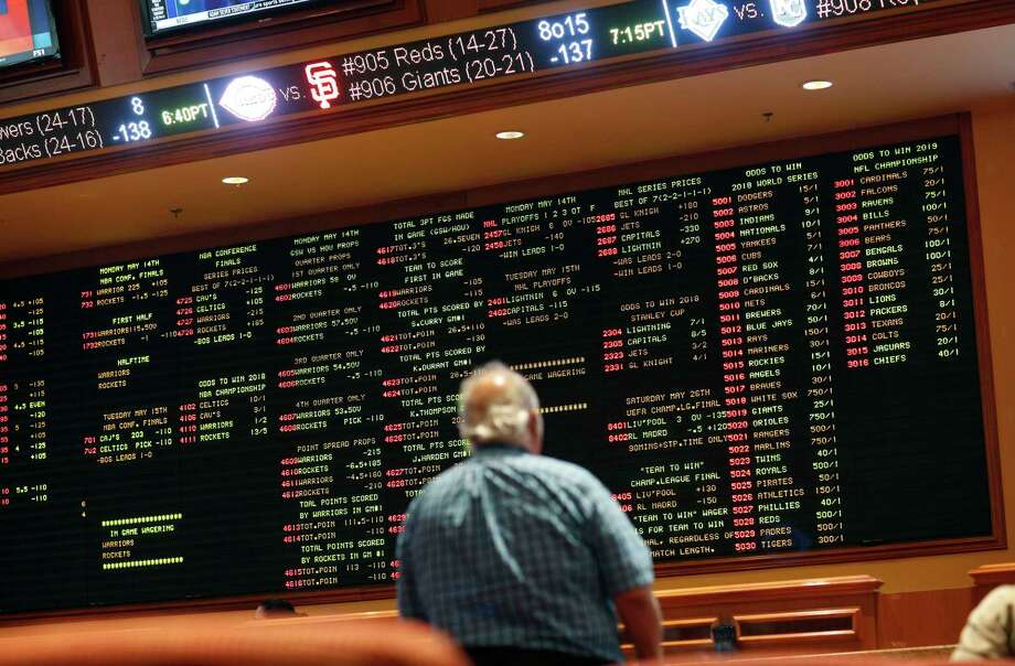 In this Monday, May 14, 2018 photo, betting odds are displayed on a board in the sports book at the South Point hotel and casino in Las Vegas. Now that the U.S. Supreme Court has cleared the way for states to legalize sports betting, the race is on to see who will referee the multi-billion-dollar business expected to emerge from the decision. (AP Photo/John Locher) Photo: John Locher / Copyright 2018 The Associated Press. All rights reserved.