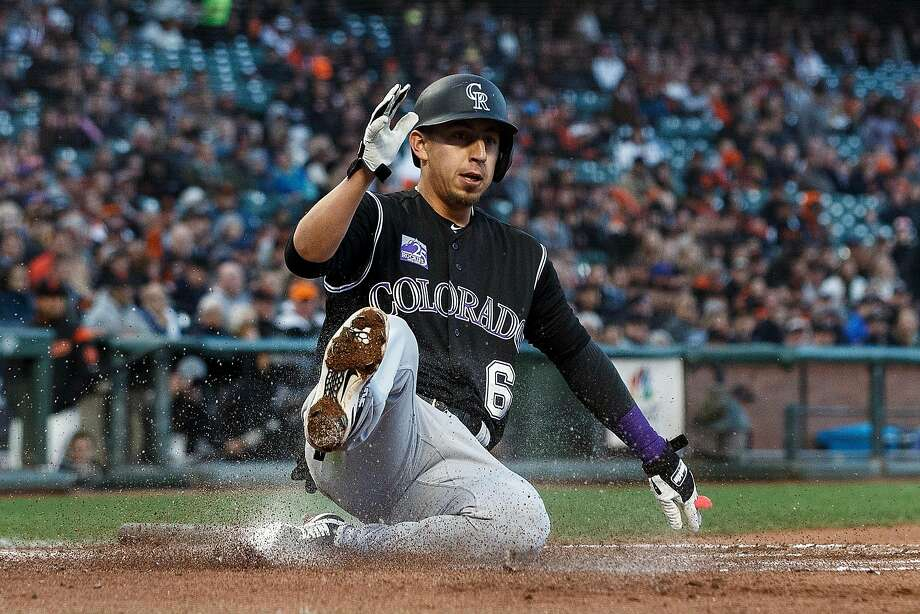 SAN FRANCISCO, CA - MAY 17:  Daniel Castro #6 of the Colorado Rockies slides into home plate to score a run against the San Francisco Giants during the second inning at AT&T Park on May 17, 2018 in San Francisco, California.  (Photo by Jason O. Watson/Getty Images) Photo: Jason O. Watson / Getty Images