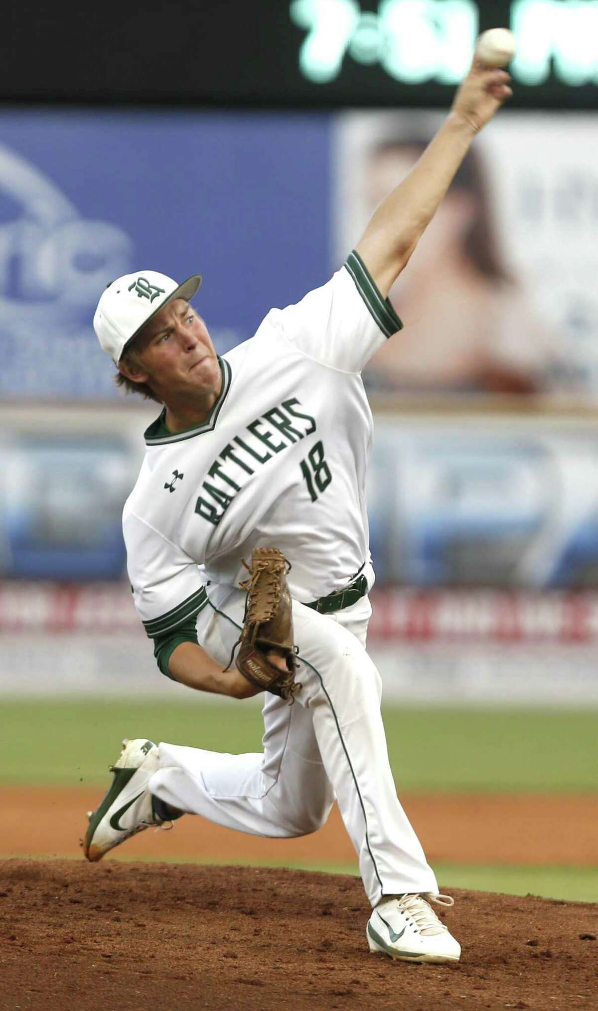 Reagan?'s Cal Carver delivers a pitch against Lake Travis from Game 1 of a Class 6A third-round high school baseball playoff series between Reagan and Austin Lake Travis at Wolf Stadium on Thursday, May 17, 2018.