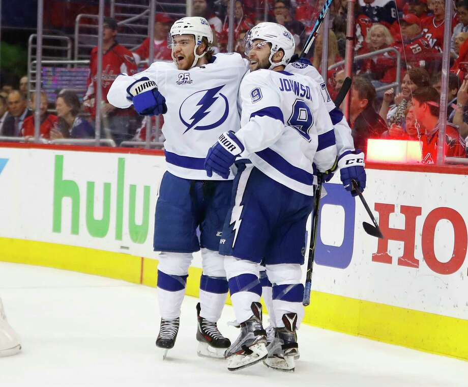 Tampa Bay Lightning center Brayden Point, left, celebrates scoring against Washington Capitals with teammates Tyler Johnson (9) and Yanni Gourde (37) during the first period of Game 4 of the NHL hockey Eastern Conference finals Thursday, May 17, 2018, in Washington. (AP Photo/Pablo Martinez Monsivais) Photo: Pablo Martinez Monsivais / Copyright 2018 The Associated Press. All rights reserved.