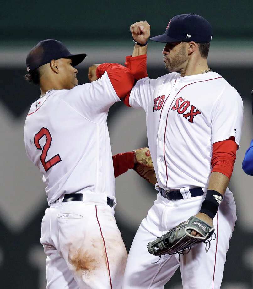 Boston Red Sox right fielder J.D. Martinez, right, and shortstop Xander Bogaerts celebrate after the Red Sox defeated the Oakland Athletics 6-4 during a baseball game at Fenway Park in Boston, Wednesday, May 16, 2018. Both Martinez and Bogaerts homered. (AP Photo/Charles Krupa) Photo: Charles Krupa / Copyright 2018 The Associated Press. All rights reserved.