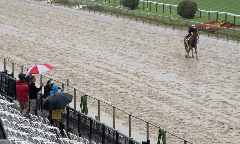 Good Magic, second in the Kentucky Derby gallops in the mud during morning exercise at Pimlico Race Course in preparation for Saturday's Preakness Stakes Thursday May 17, 2018 in Baltimore, MD (Skip Dickstein/Times Union) Photo: SKIP DICKSTEIN