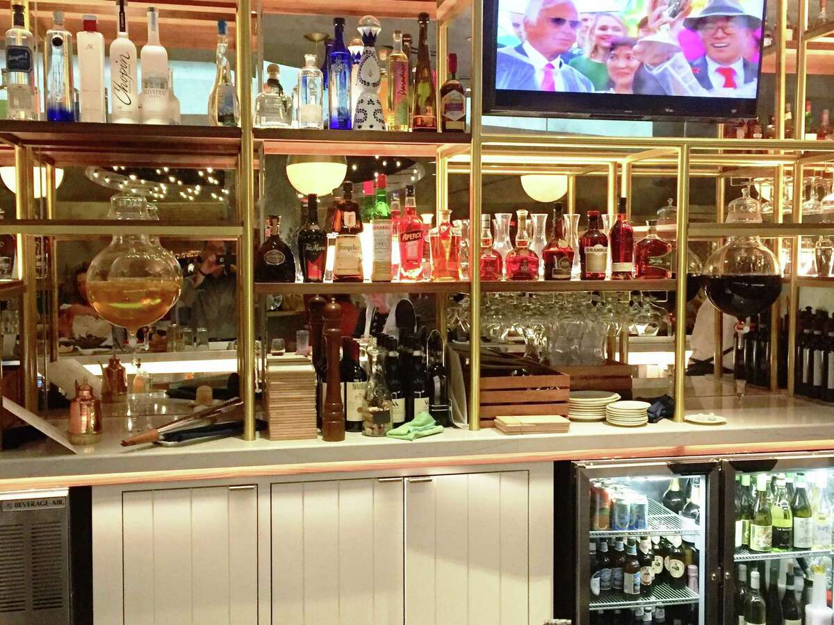 The back of the bar, with globes of limoncello and negroni.