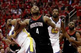 Andre Iguodala (9) gets tangled up with PJ Tucker (4) while boxing out on a free throw in the second half as the Golden State Warriors played by the Houston Rockets in Game 2 of the Western Conference Finals at Toyota Center in Houston, Texas, on Wednesday, May 16, 2018. The Rockets won 127-105.