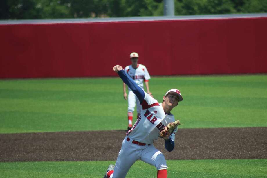 Dylan Heard shows his form on the mound that led to a perfect relief stint Thursday afternoon. He picked up the win as the Warriors improved to 3-0 for the TAPPS playoffs. Photo: Robert Avery