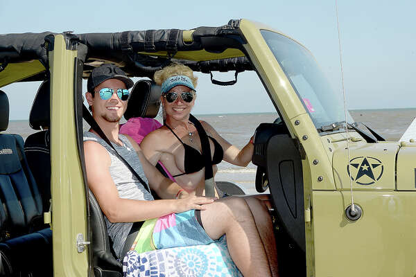 """Jeep enthusiasts enjoy the opening day at the Topless Beach Party on Crystal Beach. The annual event continues through Saturday and this year features the BF Goodrich Unlimited Off-Road Show. The """"Jeep Resort"""" site offers off-road courses, vendors, music, camping, and entertainment. Photo taken Wednesday, May 17, 2018 Kim Brent/The Enterprise"""