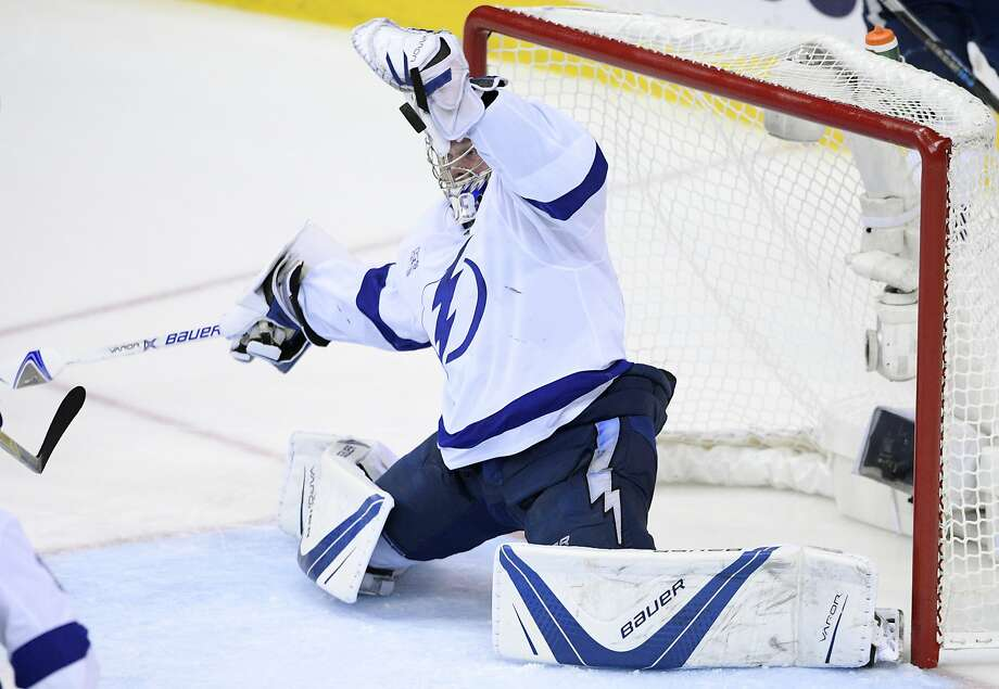 Tampa Bay Lightning goaltender Andrei Vasilevskiy, of Russia, stops the puck during the third period of Game 4 of the team's NHL hockey Eastern Conference finals against the Washington Capitals, Thursday, May 17, 2018 in Washington. The Lightning won 4-2. (AP Photo/Nick Wass) Photo: Nick Wass / Associated Press