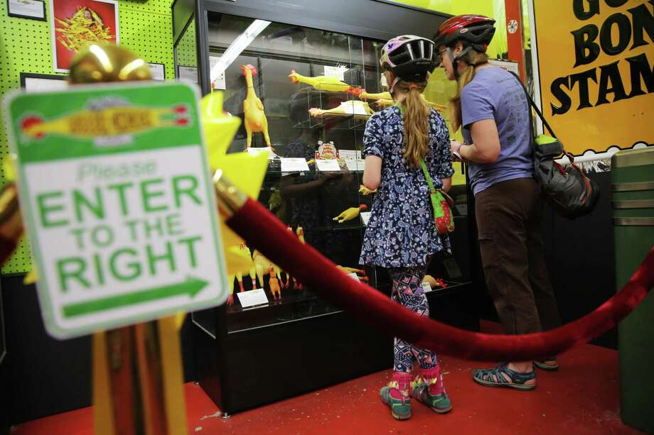 Visitors check out the Archie McPhee's Rubber Chicken Museum, Thursday, May 17, 2018. Photo: GENNA MARTIN, SEATTLEPI.COM / SEATTLEPI.COM