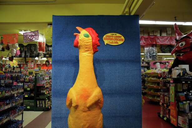 Have your photo taken with the World's Largest Rubber Chicken at Archie McPhee's Rubber Chicken Museum, Thursday, May 17, 2018.