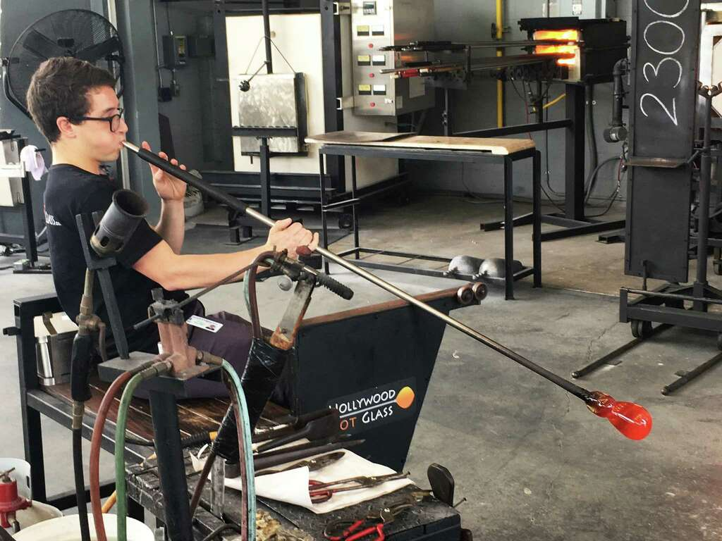 Teacher Richard Dextrade works on a vessel at Hollywood Hot Glass on Young  Circle in Hollywood
