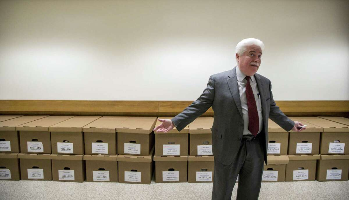 Harris County Clerk Stan Stanart talks about how the county's new iPads will make poll books, seen in the boxes behind him, obsolete, at a Harris County Administration Building, Thursday, Jan. 18, 2018, in Houston.