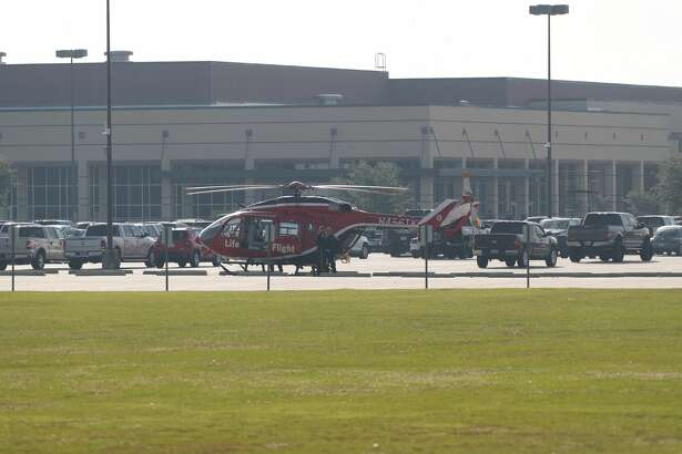 A medical helicopter lands at Santa Fe High School in Santa Fe, Texas on May 18, 2018. Officials confirmed shots had been fired at the campus.