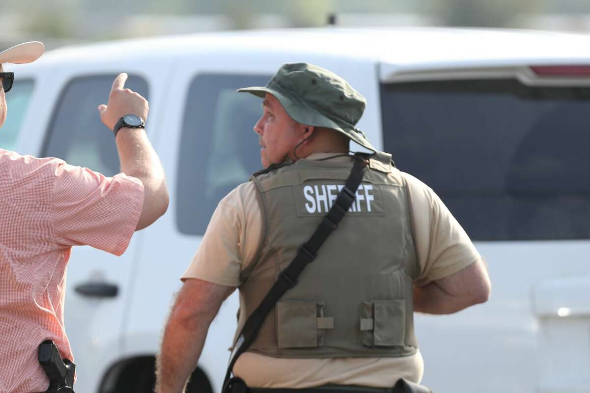 Law enforcement officers shut down traffic near Santa Fe High School in Santa Fe, Texas on May 18, 2018. Officials confirmed shots had been fired at the campus.