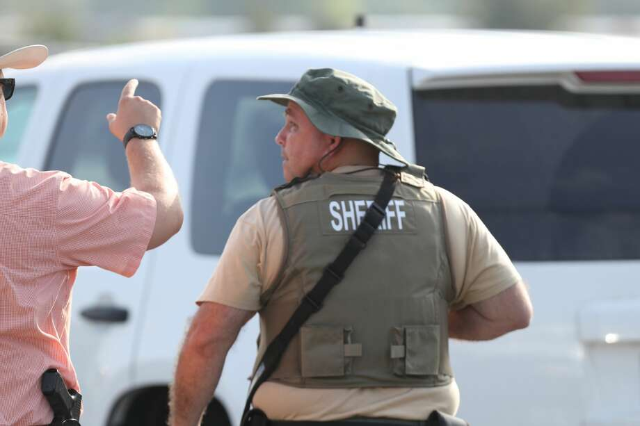 Law enforcement officers shut down traffic near Santa Fe High School in Santa Fe, Texas on May 18, 2018. Officials confirmed shots had been fired at the campus. Photo: Steve Gonzales/Houston Chronicle
