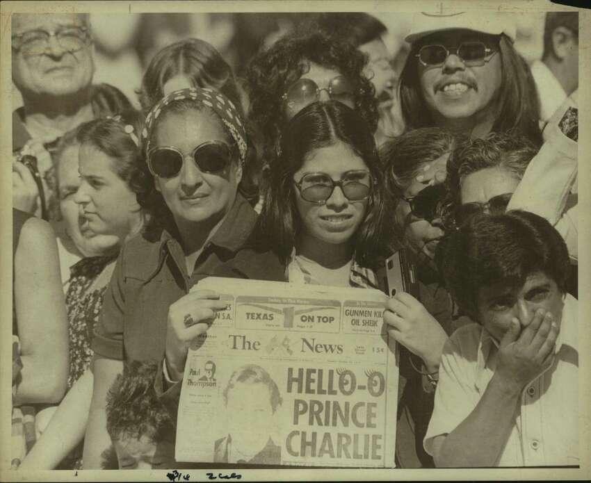 Spectators await arrival of Princes Charles in San Antonio, Texas.