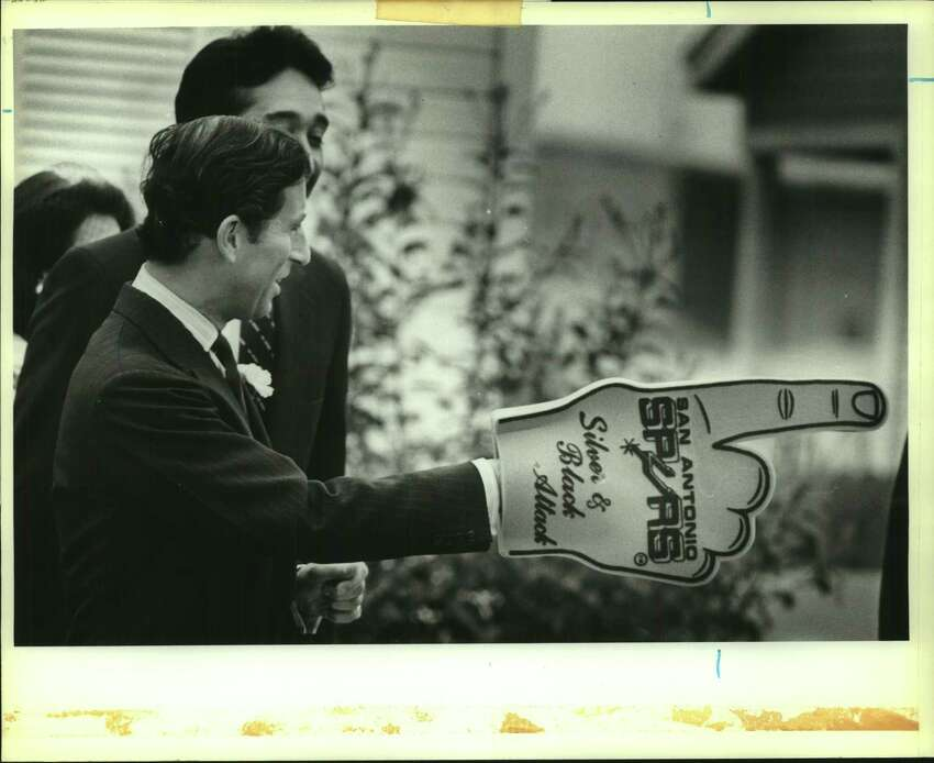 Prince Charles with Spurs foam hand during royal visit to San Antonio, Texas.