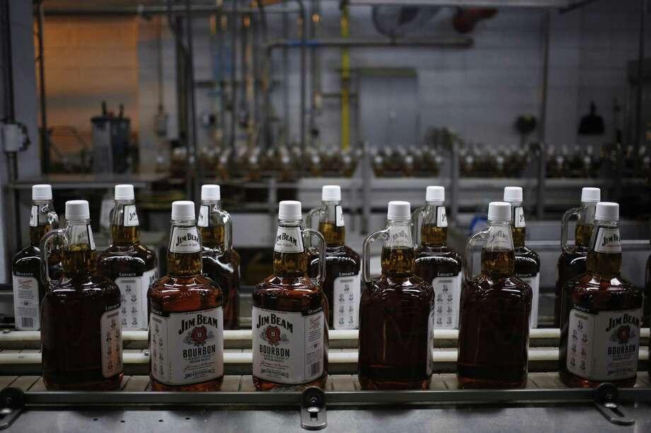 Bottles of Jim Beam Bourbon make their way down a conveyor belt inside the bottling plant at the Jim Beam Bourbon Distillery in Clermont, Kentucky. Photo: Luke Sharrett, Stringer / Getty Images / 2013 Getty Images