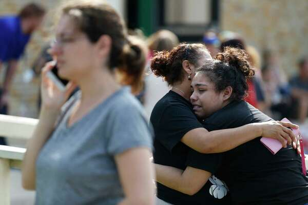 Santa Fe High School junior Guadalupe Sanchez, 16, cries into the arms of her mother, Elida Sanchez, after reuniting with her at Alamo Gym following a shooting at Santa Fe High School Friday, May 18, 2018 in Santa Fe.