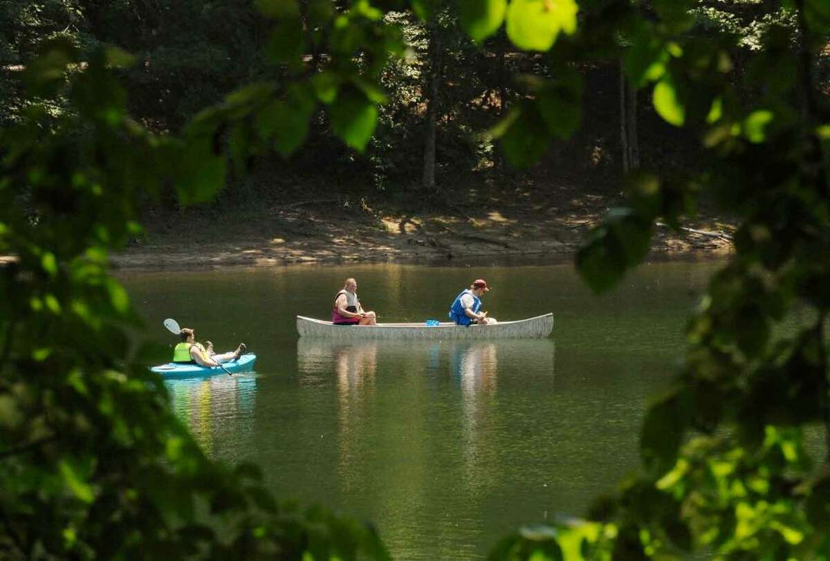 Boaters take advantage of the sunshine and smooth water on the lake at Moreau State Park in Moreau.( Michael P. Farrell / Times Union