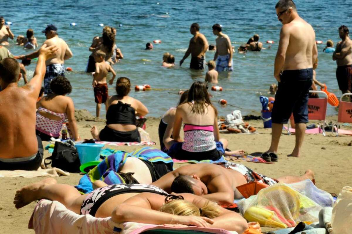 Sunbathers and swimmers on the lake at Moreau State Park in Moreau.( Michael P. Farrell / Times Union )