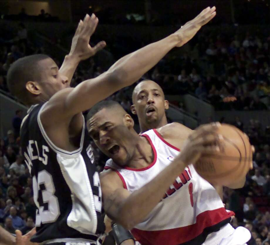 Steve Smith, battling former Spur and future teammate Antonio Daniels in 2001, said the Spurs might not have a choice to trade Kawhi Leonard if Leonard and his representatives don't want to be in San Antonio. Photo: Jack Smith / Associated Press File Photo / AP