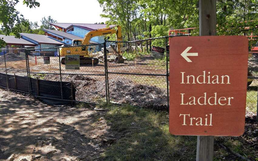 State work crews will chip away loose rock from the cliff face at the Indian Ladder Trail in Thacher State Park in a bid to reopen the trail later this summer. The trail has been closed since a falling rock struck and seriously injured a woman last summer. (John Carl D'Annibale / Times Union)