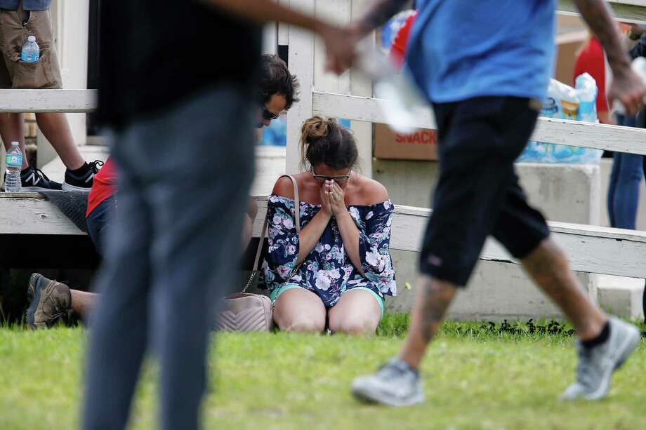 A woman prays as parents wait to reunite with their kids following a shooting at Santa Fe High School on Friday, May 18, 2018, about 30 miles from Houston. Photo: Michael Ciaglo, Houston Chronicle