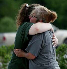 Santa Fe High School staff react as they gather in the parking lot of a gas station following a shooting at the school in Santa Fe, Texas, on Friday, May 18, 2018.   (Jennifer Reynolds/The Galveston County Daily News via AP)