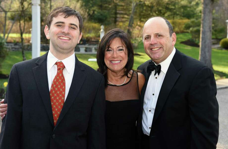 From left, Eric Parkes joined his parents, Penney and David Parkes, of Fairfield, at Ability Beyonds Masquerade Gala fundraiser on April 28 in Danbury. The Parkes served as co-chairs of the event. Photo: /