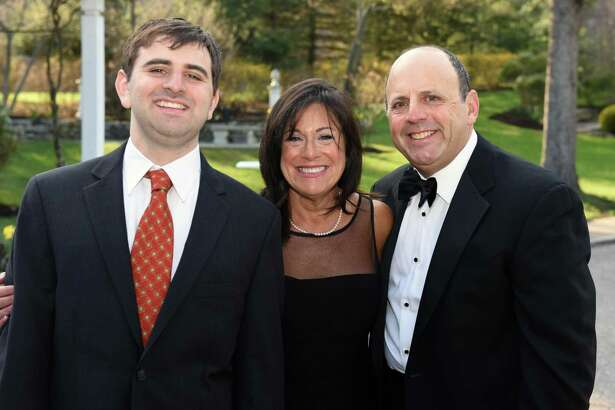 From left, Eric Parkes joined his parents, Penney and David Parkes, of Fairfield, at Ability Beyonds Masquerade Gala fundraiser on April 28 in Danbury. The Parkes served as co-chairs of the event.