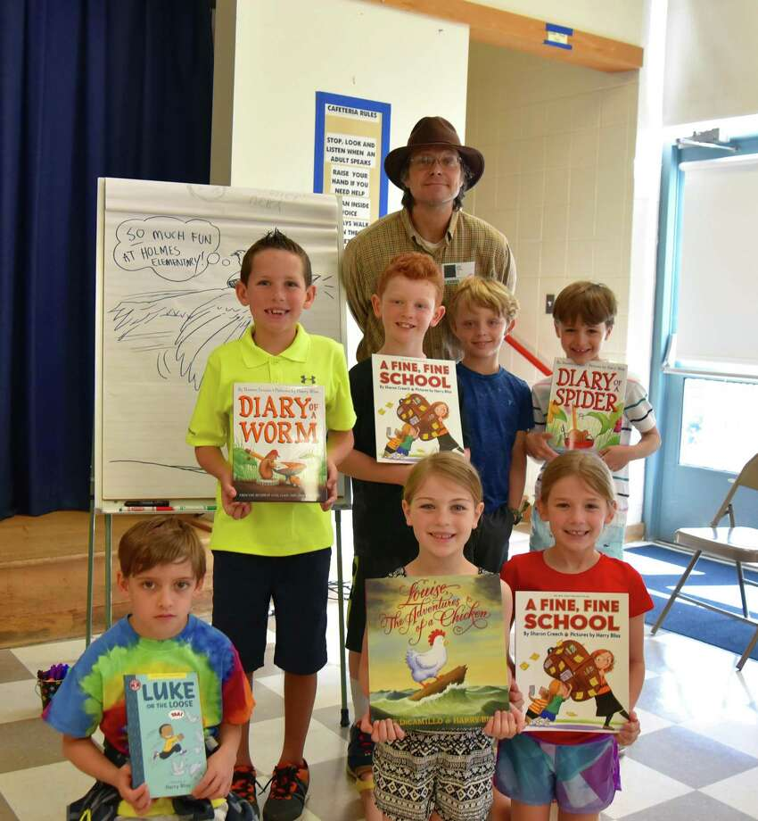 Illustrator and author Harry Bliss visited Holmes Elementary School to share how he uses creative thinking in his drawing and writing. Front row: Teddy van de Kamp, Noelle Graham and Maddie Hite; back row: Blake Moore, Brady Schaller, Bliss, Ryan Fisch and Henry MacLane. Photo: Contributed Photo