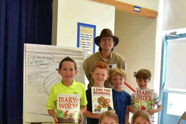 Illustrator and author Harry Bliss visited Holmes Elementary School to share how he uses creative thinking in his drawing and writing. Front row: Teddy van de Kamp, Noelle Graham and Maddie Hite; back row: Blake Moore, Brady Schaller, Bliss, Ryan Fisch and Henry MacLane.