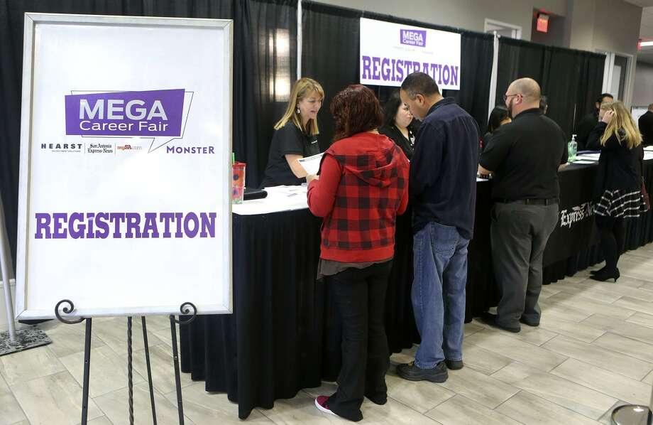 People register Wednesday February 21, 2018 at the Mega Career Fair at the Norris Conference Center on Loop 410. Twenty six companies were represented at the event offering employment in manufacturing, transportation, healthcare and more. Photo: John Davenport, STAFF / San Antonio Express-News / ©John Davenport/San Antonio Express-News
