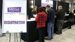 People register Wednesday February 21, 2018 at the Mega Career Fair at the Norris Conference Center on Loop 410. Twenty six companies were represented at the event offering employment in manufacturing, transportation, healthcare and more.