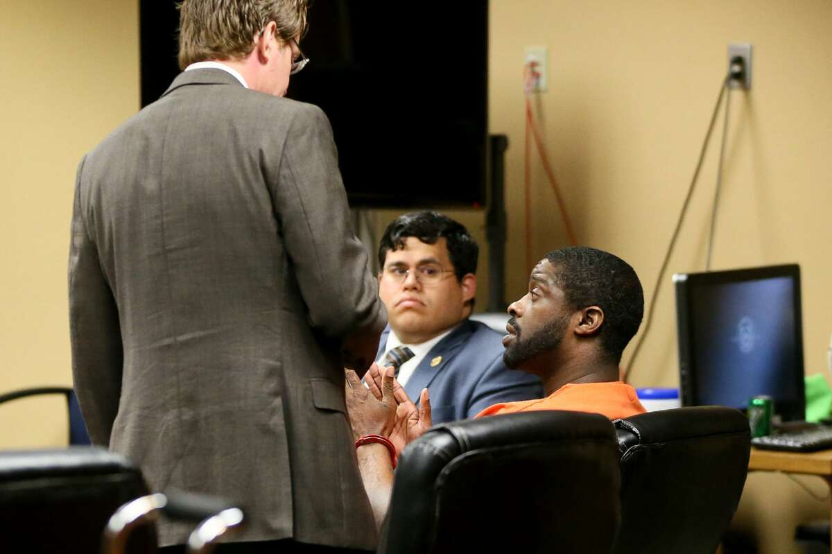 Deandre Dorch talks with defense attorney Edward Bravenec (left) and co-counsel Patrick Lamas before sentencing in the Felony Impact Court, presided by Judge Laura Parker, in the Bexar County Courthouse on Friday, May 18, 2018. Dorch, convicted of injury to a child by omission and abandonment of a child in the horrific case of two children who were tied up like dogs and left in the backyard of a home in Northeast Bexar County, received a sentence of 65 years in jail but will be eligible for parole in 30 years. MARVIN PFEIFFER/mpfeiffer@express-news.net