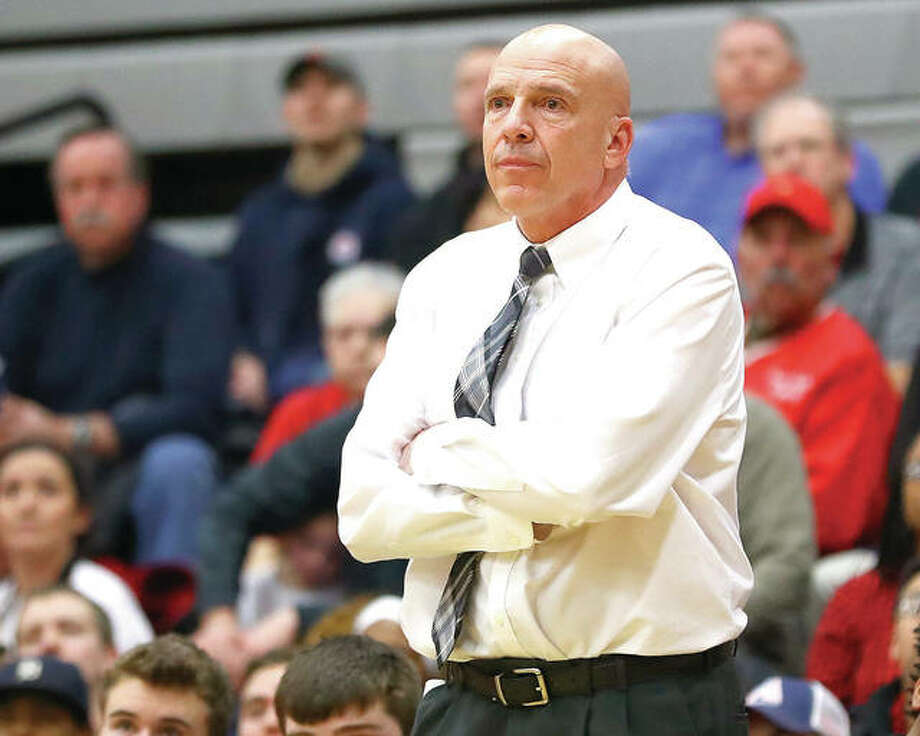 Edwardsville coach Mike Waldo watches play during the Tigers' victory over Alton in a Class 4A regional championship in 2017 at Granite City. The former Tigers coach will continue his career as an assistant basketball coach for the Jefferson City Jays in Missouri. Photo:     Billy Hurst / Telegraph File Photo