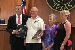 """Katy Mayor Chuck Brawner recognized Douglas """"Pat"""" Gorman as the City of Katy's 2018 Senior Citizen of the Year at the May 14 Katy City Council meeting. From left are Brawner, Gorman and Gorman's wife, Francesca, and daughter, Karen."""