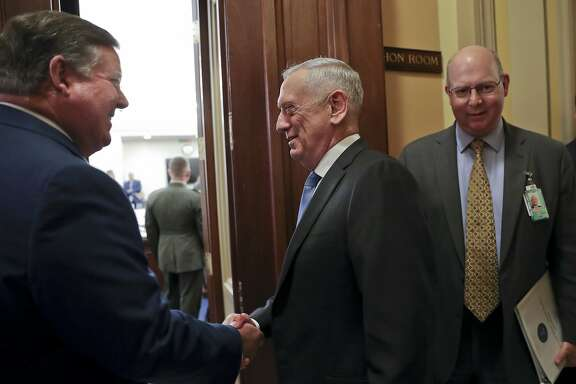 Rep. Ken Calvert, R-Calif., left, greets Defense Secretary Jim Mattis, center, before the start of a closed meeting before the House Appropriations subcommittee on budget on Capitol Hill in Washington, Wednesday, April 25, 2018. (AP Photo/Pablo Martinez Monsivais)