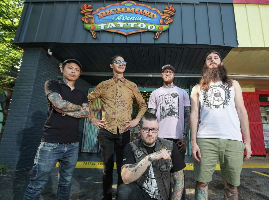 Richmond Ave. Tattoo owner / tattoo artist Jared Green (center) and his team (left-right) Brandon Madrid, Antone Pham, Green, Cambo and Kevin Poon pose in front of the shop Thursday, May 17, 2018, in Houston. Green will be the NRG tattoo convention this weekend. ( Steve Gonzales / Houston Chronicle ) Photo: Steve Gonzales, Houston Chronicle / Houston Chronicle / © 2018 Houston Chronicle