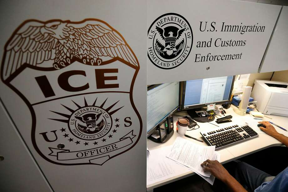An unidentified Immigration and Customs Enforcement deportation officer reviews forms at the the Pacific Enforcement Response Center in Laguna Niguel, Calif., on April 26, 2017.  Photo: Allen J. Schaben, TNS