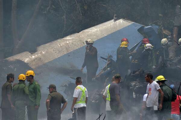 "Emergency personnel work at the site of the accident after a Cubana de Aviacion aircraft crashed after taking off from Havana's Jose Marti airport on May 18, 2018. - A Cuban state airways passenger plane with 113 people on board crashed on shortly after taking off from Havana's airport, state media reported. The Boeing 737 operated by Cubana de Aviacion crashed ""near the international airport,"" state agency Prensa Latina reported. Airport sources said the jetliner was heading from the capital to the eastern city of Holguin."