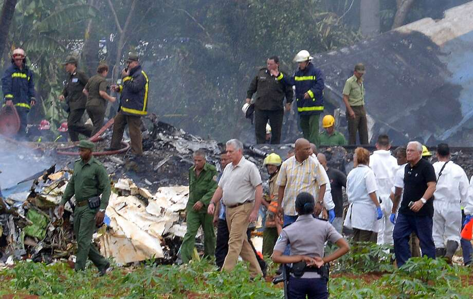 "Cuban President Miguel Diaz-Canel (C) is pictured at the site of the accident after a Cubana de Aviacion aircraft crashed after taking off from Havana's Jose Marti airport on May 18, 2018. - A Cuban state airways passenger plane with 113 people on board crashed on shortly after taking off from Havana's airport, state media reported. The Boeing 737 operated by Cubana de Aviacion crashed ""near the international airport,"" state agency Prensa Latina reported. Airport sources said the jetliner was heading from the capital to the eastern city of Holguin. Photo: ADALBERTO ROQUE/AFP/Getty Images"