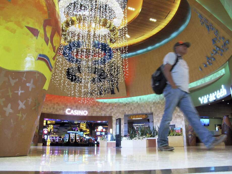 A man walks through the lobby of the Navajo Nation's Twin Arrows Casino, east of Flagstaff, Ariz., Tuesday, May 15, 2018. American Indian tribes are welcoming the opportunity to add sports betting to potentially hundreds of casinos across the country after the U.S. Supreme Court cleared the way for states to legalize it. Photo: Felicia Fonseca /Associated Press / AP2018