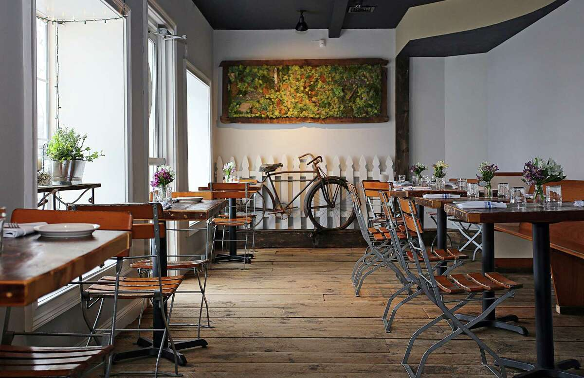 It is a tale of sea and land at Lucas Local, a restaurant that opened in Newtown, Connecticut, in late 2017. The owner, Vincent Cappelletti, designed the restaurant himself, with lots of help from family and friends. A wall of moss hangs on a far wall -- a kind of treasure map of the places he has visited with his family. The rusty bike was discovered roadside, along with a section of white picket fence.
