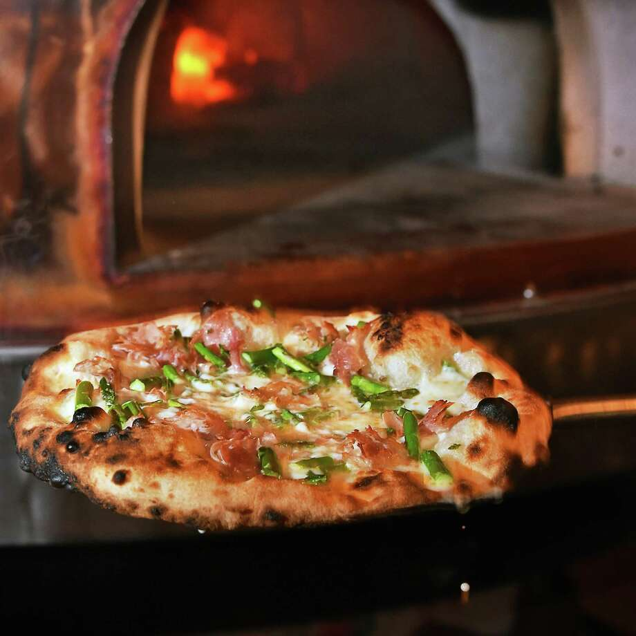 A Rosatoe e verde specialty pizza right out of the French Le Panyol wood-fired oven at Taverna Novo on Beekman Street Wednesday May 9, 2018 in Saratoga Springs, NY.  (John Carl D'Annibale/Times Union) Photo: John Carl D'Annibale / 20043725A
