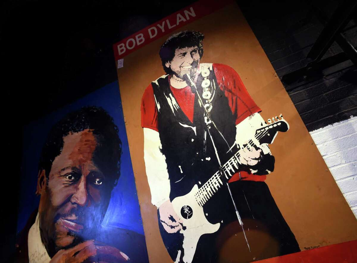A painting inspired by a photograph of Bob Dylan by former New Haven Register photographer Peter Tobia taken on January 12, 1990 hangs at Toad's Place in New Haven on February 1, 2018.