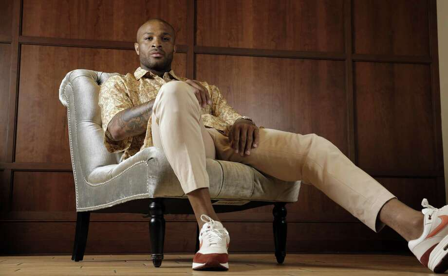 Houston Rockets' P.J. Tucker poses in a shirt and pants from Dries Van Noten with Nike Air Max 1 shoes Tuesday, May 15, 2018, in Houston. Tucker's playing style and defensive grit helped the Houston Rockets to the Western Conference Finals. Off the court Tucker has spent years personally curating a wardrobe that has helped his style ascend to the upper echelons of fashion. Photo: David J. Phillip, STF / Associated Press / AP